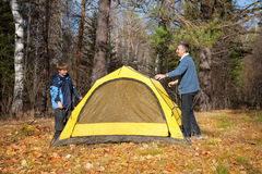 Tent in autumn forest Royalty Free Stock Images
