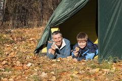 Tent in autumn forest Royalty Free Stock Image