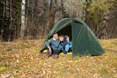 Tent in autumn forest Stock Image