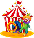 A tent at the back of the clown and the ring of fire Royalty Free Stock Image