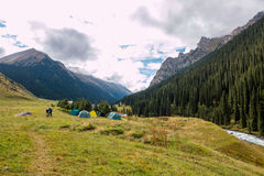 Tent basecamp in mountain river valley Royalty Free Stock Photo