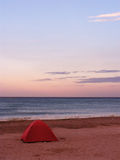 Tent on a beach. In the sunset stock photo