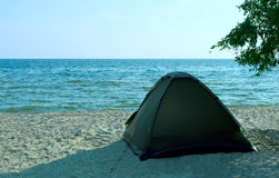Tent on the beach. Tent on the solitude beach. Kinburn Spit, near Ochakiv, Ukraine Royalty Free Stock Image