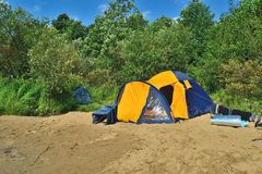 Tent on beach. Tent outdoors - camping on river beach Royalty Free Stock Images