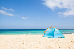 Tent at the beach. Camping with a tent at a lonesome beach with a turquoise sea and blue sky in the background, Fuerteventura, Canary Islands, Spain, Europe Royalty Free Stock Photos