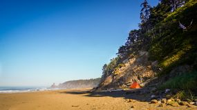 Tent at the beach by cliff royalty free stock photo