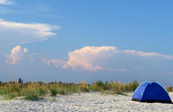 Tent on the beach at sunset Stock Photography