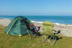 Tent on the beach. With two chairs standing on the grass. ..journey to Georgia Royalty Free Stock Images