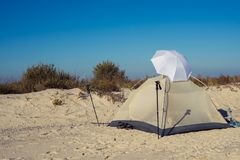 Tent on the beach. At a wonderful sunny day. Magical camp on the wild sea shore Stock Photography