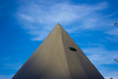 Tent on the blue sky. Royalty Free Stock Image