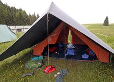 Tent of boy scout with backpacks and sleeping bags spread out. Big tent of boy scout campsite with backpacks and sleeping bags spread out Royalty Free Stock Images