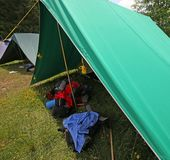 Tent of boy scout camp with backpacks and sleeping. Big tent of boy scout camp with backpacks and sleeping bags spread out Royalty Free Stock Photo