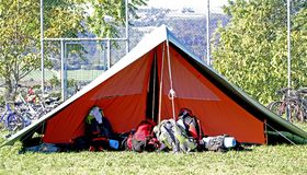 Tent of boy scout camp and the rucksack put out in the open air Royalty Free Stock Photos