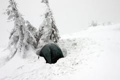 Tent Buried in Snow in Misty Winter Landscape Stock Photos