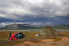 Tent camp. With canoe, bags and a beautiful panoramic view Stock Photos