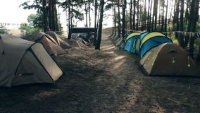 Tent camp in first rays of sun. Tent camp in the first rays of sun stock footage