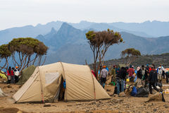 Tent camp on mountain. Kilimanjaro, with its three volcanic cones, Kibo, Mawenzi, and Shira, is a dormant volcano in Kilimanjaro National Park, Tanzania and the Royalty Free Stock Images