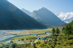 Tent camp near the lake Akkem, Mount Belukha. Trekking in the Altai Mountains Stock Image