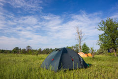Tent camp in sunny morning lights. Beautiful sammer nature.  Stock Image