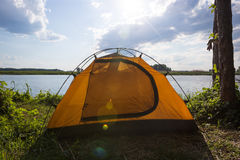 Tent camp in sunny morning lights. Beautiful sammer nature near river Stock Photography