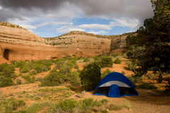 Tent Camping. In the desert with rock formations in the background stock photography