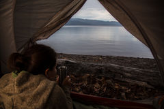 Tent camping on Babine Lake. Summer sunrise camping at Pendleton bay on Babine lake stock photo