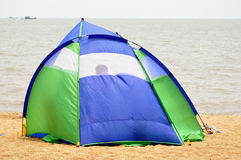 Tent camping on the beach. A closeup of a camping tent set up close to the water's on a beach Stock Image