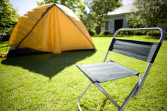 Tent and camping chair in backyard stock photography