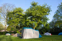 Tent on a camping ground at sunrise Stock Photos