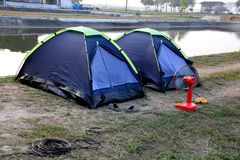 Tent outdoors by the pool. Tent camping outdoors by the pool, fresh morning air Stock Photo