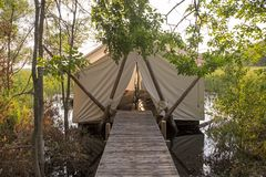 Tent camping over water Royalty Free Stock Photography