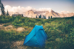 Tent camping with Rocky Mountains Landscape Stock Image