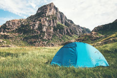 Tent camping and rocky Mountains Landscape Stock Image