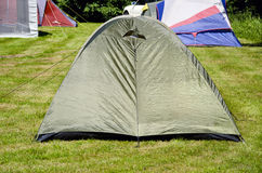Tent camping on summer grass Royalty Free Stock Photo