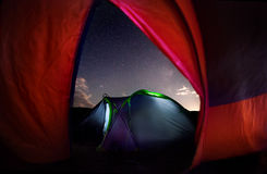 Tent camping under starry night Royalty Free Stock Photo