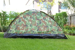 Tent camping wild camouflage style. Design of backyard in green grass garden field Royalty Free Stock Image