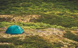 Tent Camping in the Wild. Small Tent on the Remote Mountain Landscape Meadow Stock Images