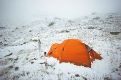 Tent camping in winter mountains Stock Photos