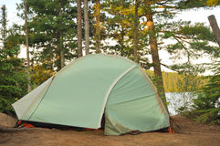 Tent at Campsite in the Wilderness. By a Remote Lake in Northern Minnesota royalty free stock image