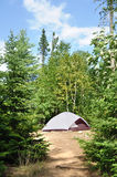 Tent at Campsite in the Wilderness. On a Sunny Summer Day royalty free stock images