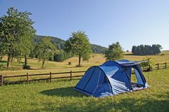 Tent campsites planted amidst the mountain meadow Green Stock Photo