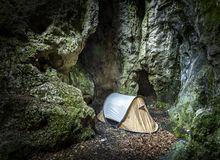 Tent in cave, extreme camping for climbers. Stock Photos