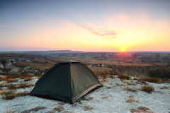 Tent on the chalk hill at sunset. Stock Photo