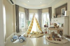 A tent in children room. Tent, dolls and alot of toys in the children room of happy home royalty free stock photos