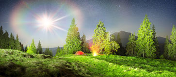 Tent and cyclist night Royalty Free Stock Image