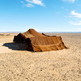tent in  the desert of mor occo sahara and rock  stone    sky Royalty Free Stock Image