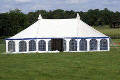 Tent in a field for an event. event tent. tent. Outdoor view of a field with an event tent Royalty Free Stock Image