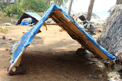 Tent for fishing boats on the beach. India Stock Photos
