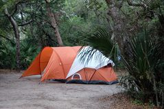 Tent in forest clearing Stock Images