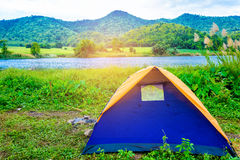 Tent in the forest on holiday Stock Photos
